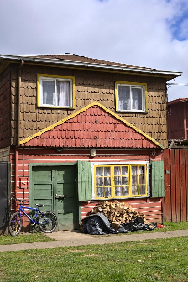 Traditional House with Shingles in Osorno, Chile. OSORNO, CHILE - SEPTEMBER 19, 2015: Colorfully painted house built in traditional way with wooden shingle in royalty free stock photo