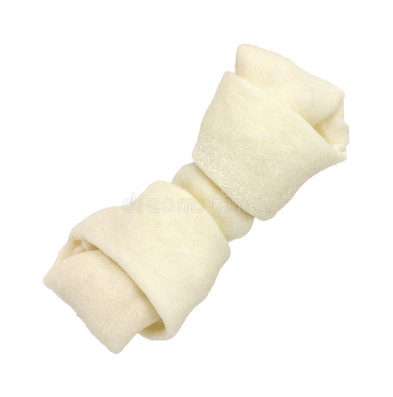 Osso di cane del pellame greggio su priorità bassa bianca fotografia stock