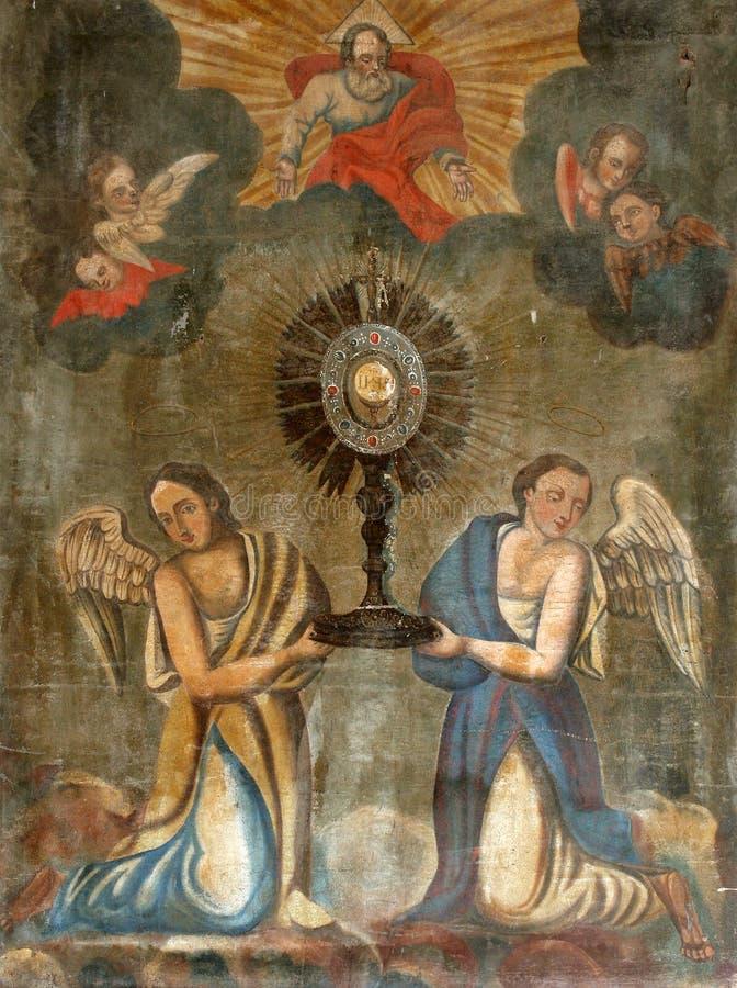 Ostensoir eucharistique d'adoration avec le sacrement béni image stock