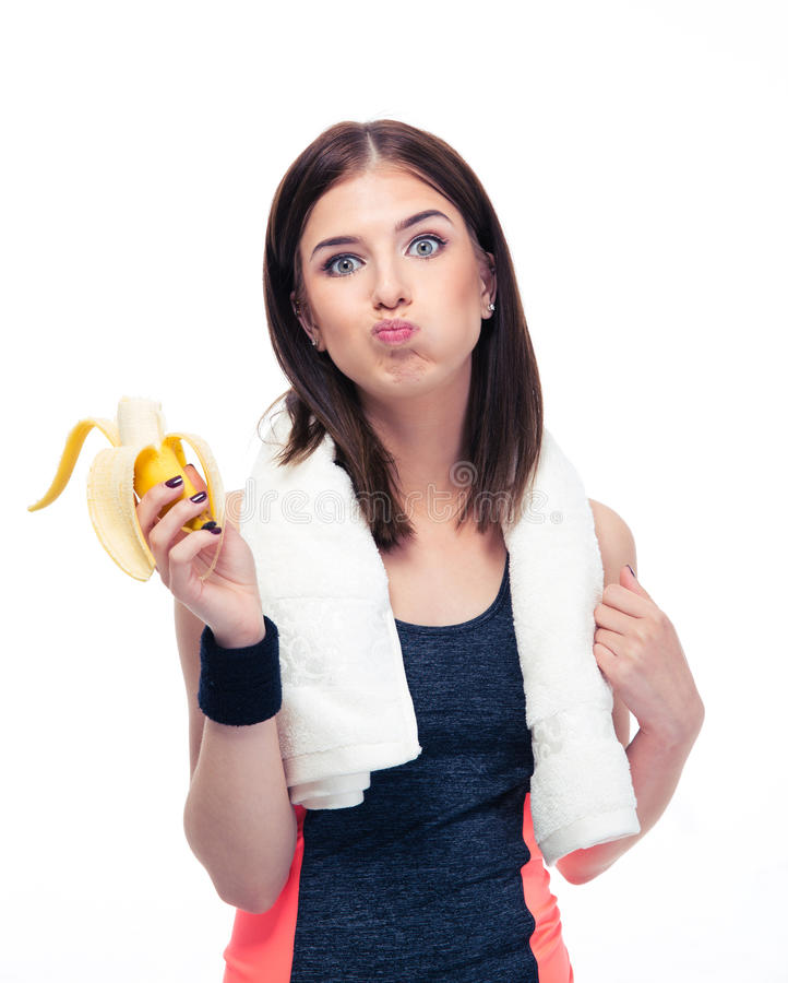 Ostenta a mulher que come a banana fotos de stock