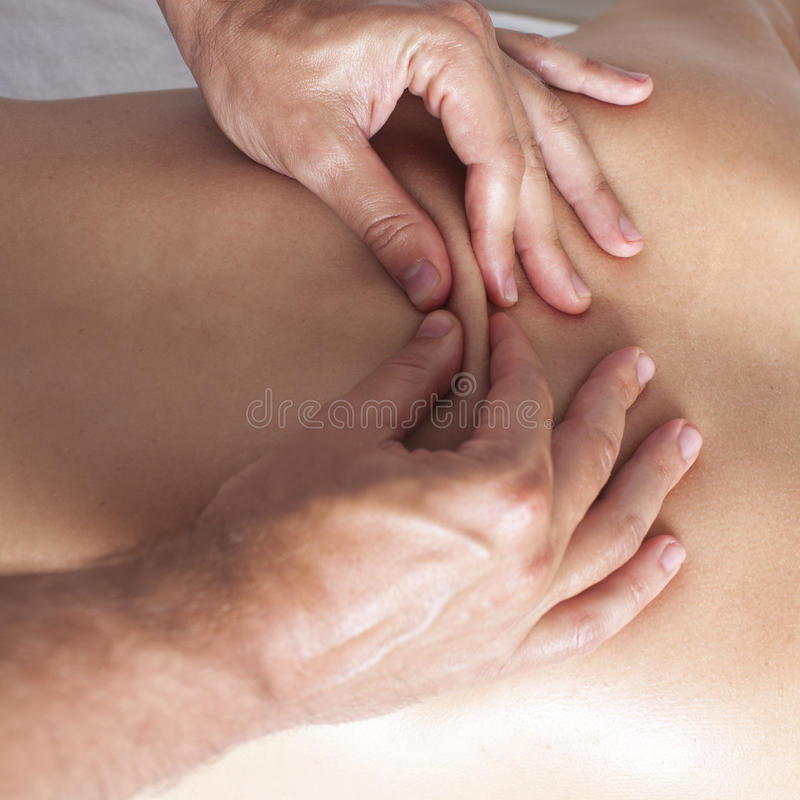 Osteopathic medicine. Chiropractic applying myofacial therapy on female back stock images