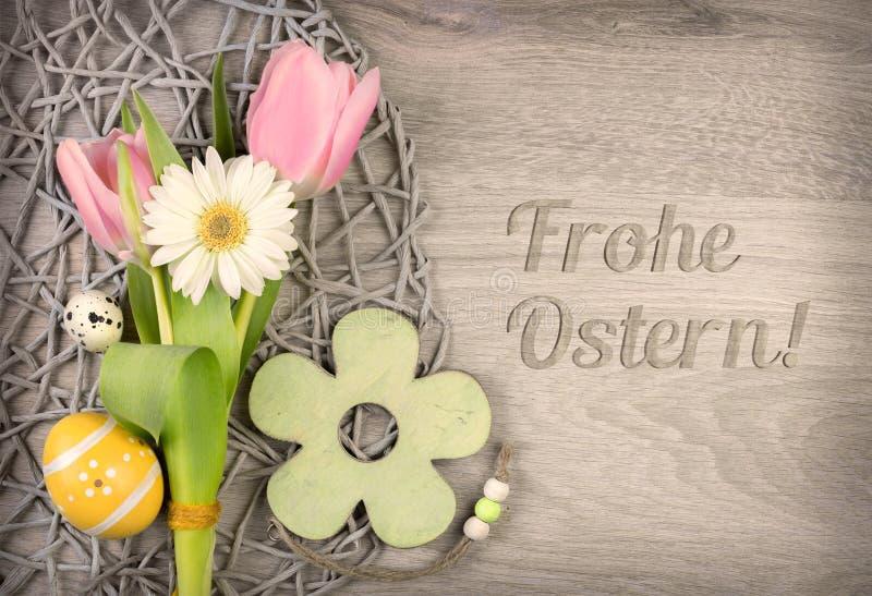 Ostern-arragement und -titel stockbild