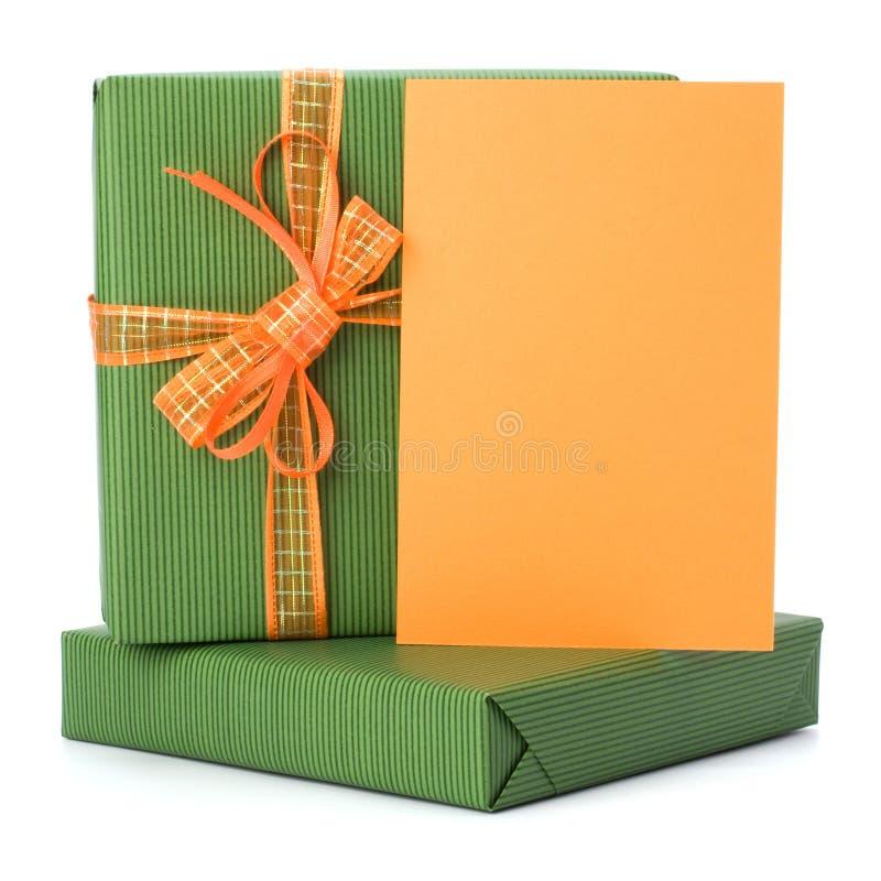 Ostern-Geschenke mit Grußkarte lizenzfreie stockbilder