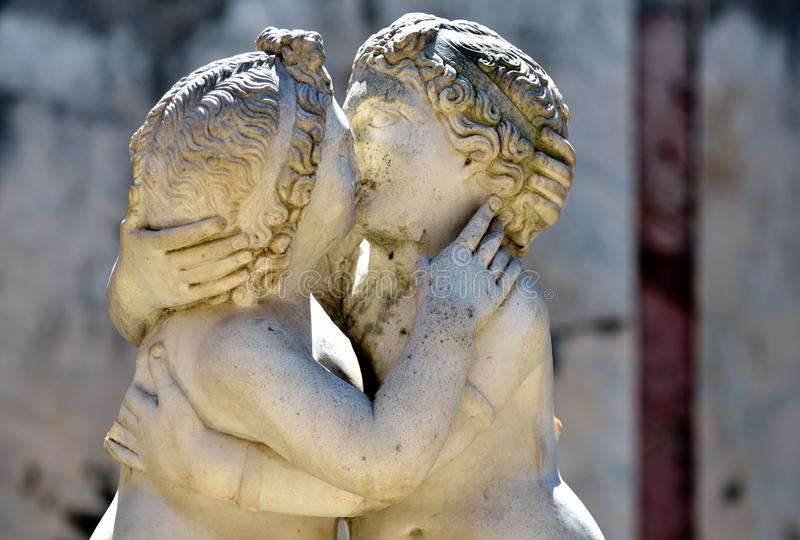 Ostia Antica, ancient Roman sculpture of Cupid and Psyche. Kissing Cupid and Psyche sculpture at Ostia Antica, location of the harbour city of ancient Rome stock photo