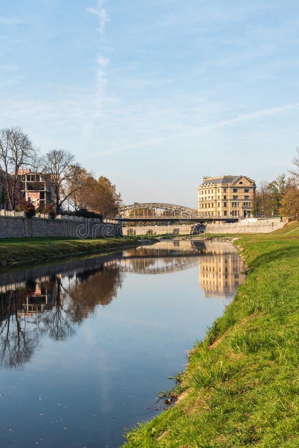 Ostravice river with Most Milose Sykory bridge in Ostrava city in Czech republic. During nice autumn day stock photo