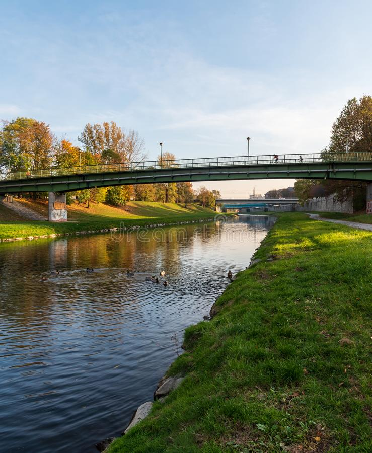 Ostravice river in Ostrava city in Czech republic during nice autumn day. Ostravice river with bridges above and colorful trees around in Ostrava city in Czech royalty free stock images