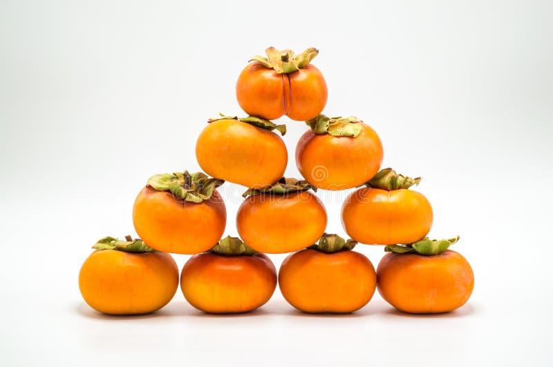 Ostrosłup persimmons odizolowywający na bielu zdjęcie royalty free