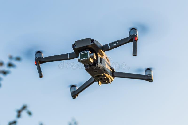 Flying drone DJI Mavic 2 Pro. Ostrow Wielkopolski, Poland - September 30, 2018: Flying drone DJI Mavic 2 Pro royalty free stock image
