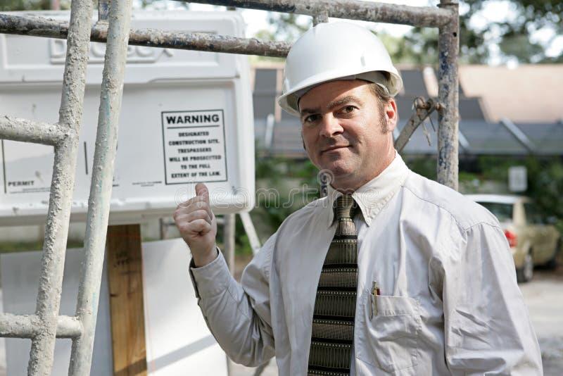 ostrzeżenie inspektora budynku. obraz stock