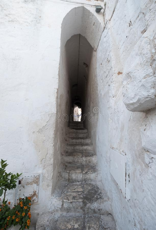 Ostuni Italy. White washed buildings and passageway on a street in Ostuni in Puglia, Southern Italy. stock photos