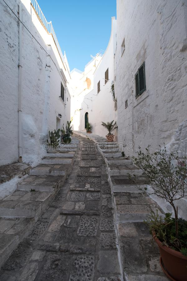 Ostuni Italy. White washed buildings and passageway on a street in Ostuni in Puglia, Southern Italy. stock image