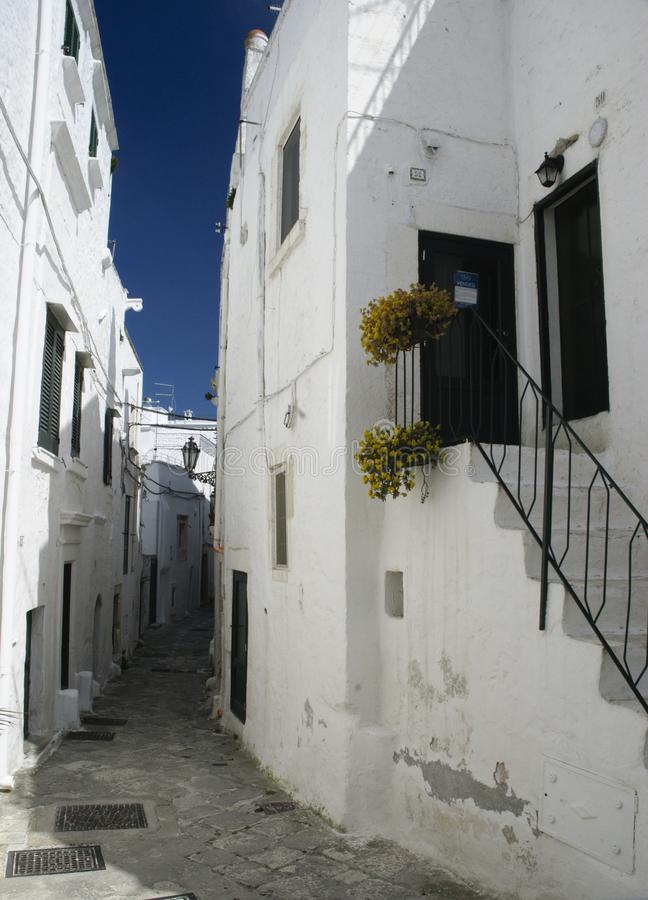 Ostuni, Puglia, Italy: Alley in the old town stock photo