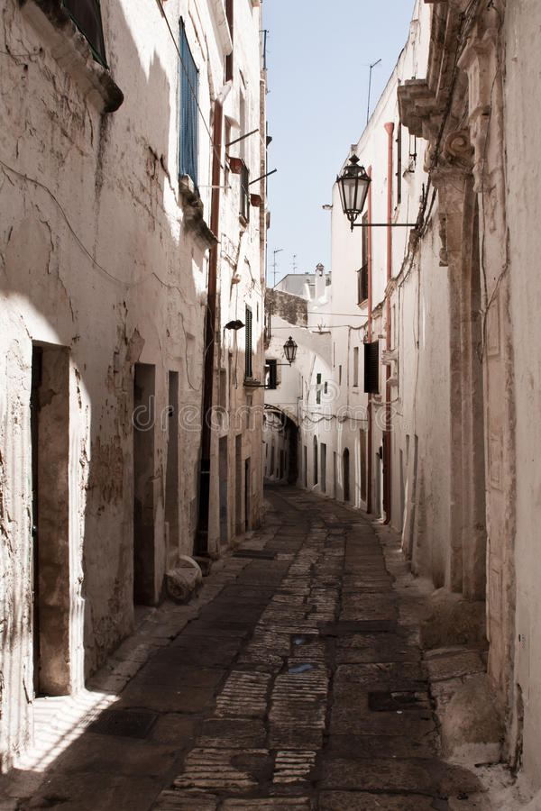 Ostuni street. The White City , because of its quaint old town that was once entirely painted with white lime , today only partially . Its territory is part of stock photography