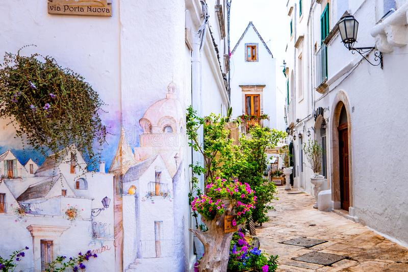 OSTUNI, APULIA, ITALY – AUGUST 10, 2018: Typical street of Ostuni, La Citta Bianca. Ostuni. Apulia, Italy stock image