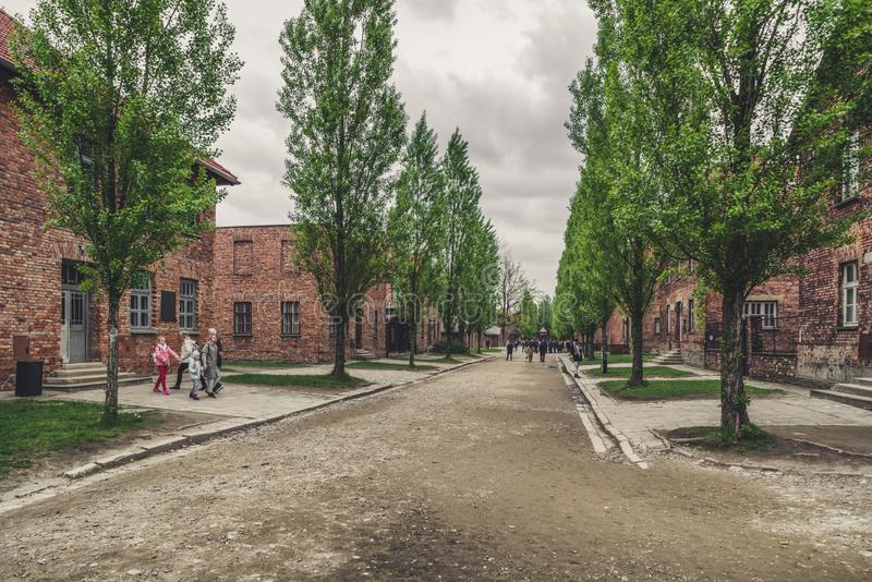 Visitors in at concentration camp in Auschwitz I, Poland royalty free stock images
