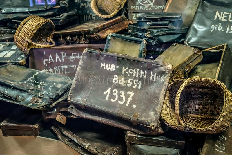 Oswiecim / Poland - 02.15.2018: Personal belongings, suitcases, bags, baskets. Exhibition of prisoners personal belongings, suitcases, bags, baskets with the royalty free stock photos
