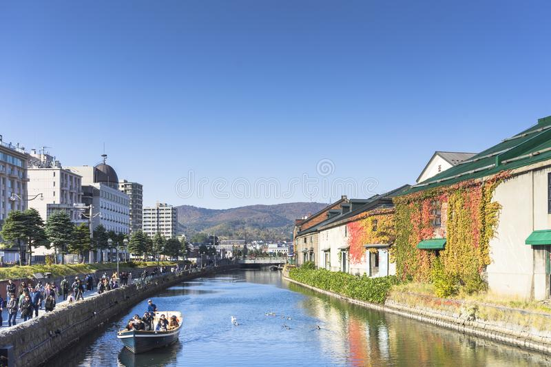 Otaru, Japan - October 19, 2017 : Unknown tourists on Otaru canal cruise, bright beautiful autumn day. royalty free stock image