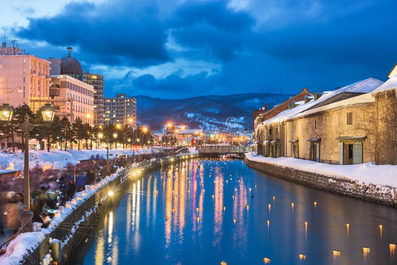 Otaru, Japan Winter Skyline. On the canals during the twilight light up stock photos