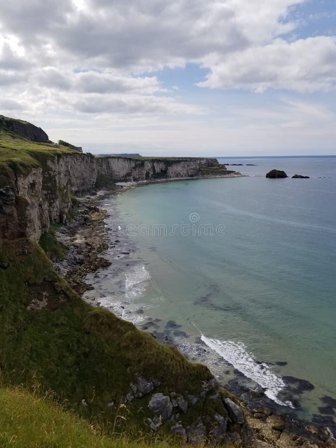 The other Irish cliffs. Other irish cliffs carrickarede ocean ireland travel destination tourists bluewater nature beauty summer day stock photography
