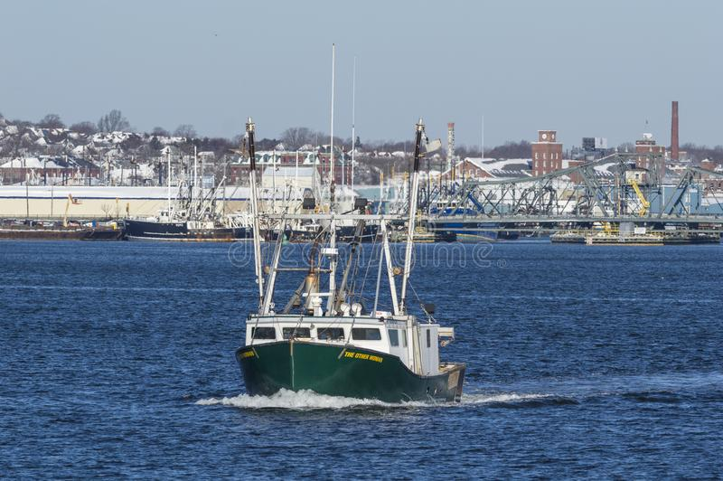 The Other Woman leaving Fairhaven. New Bedford, Massachusetts, USA - January 31, 2018: Commercial fishing vessel The Other Woman leaving Fairhaven with New royalty free stock photo