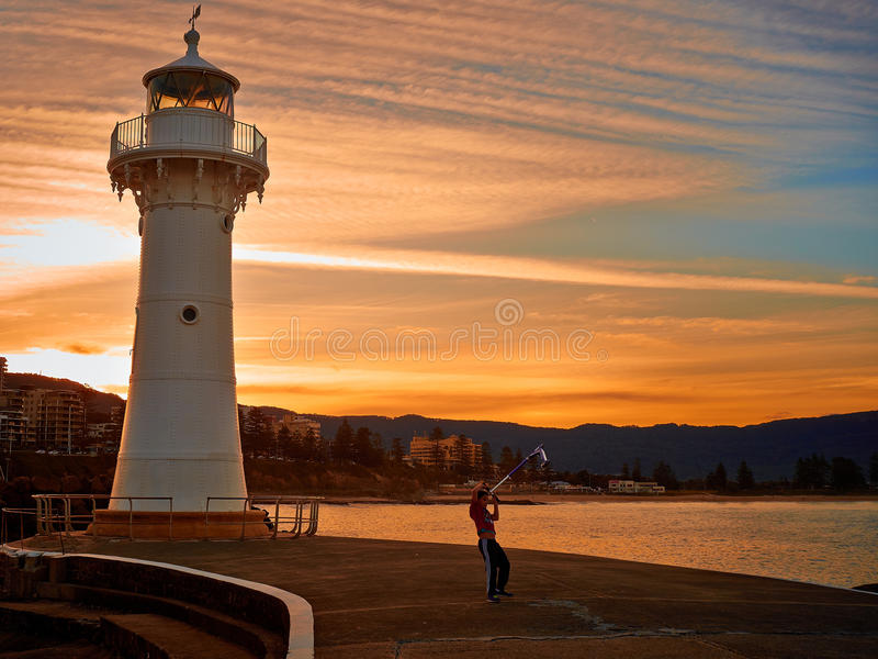 Otopet kid under the lighthouse stock photo