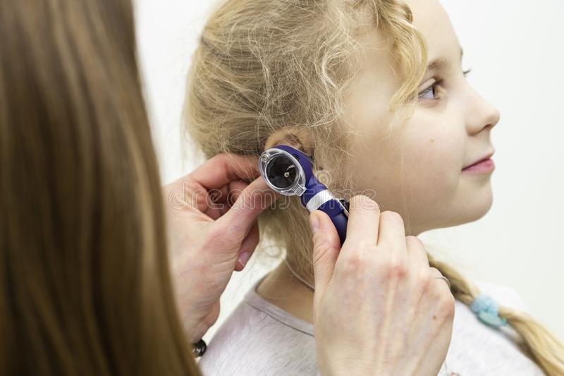 Otoscope hearing test. The doctor applies the otoscope to the ear. hearing test with a special device stock photos