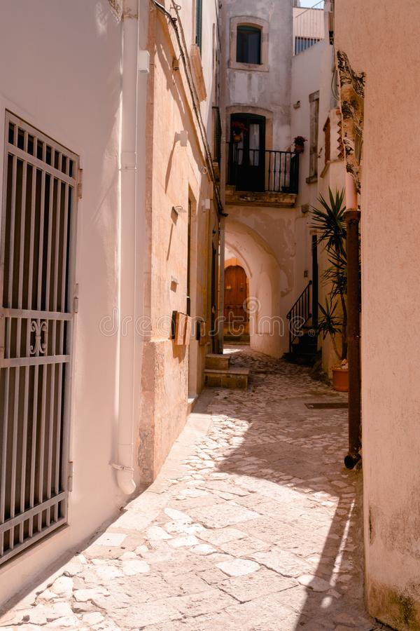 Otranto, Italy 15 August 2019: a tiny and narrow alley in the old town of Otranto during the summer stock photos