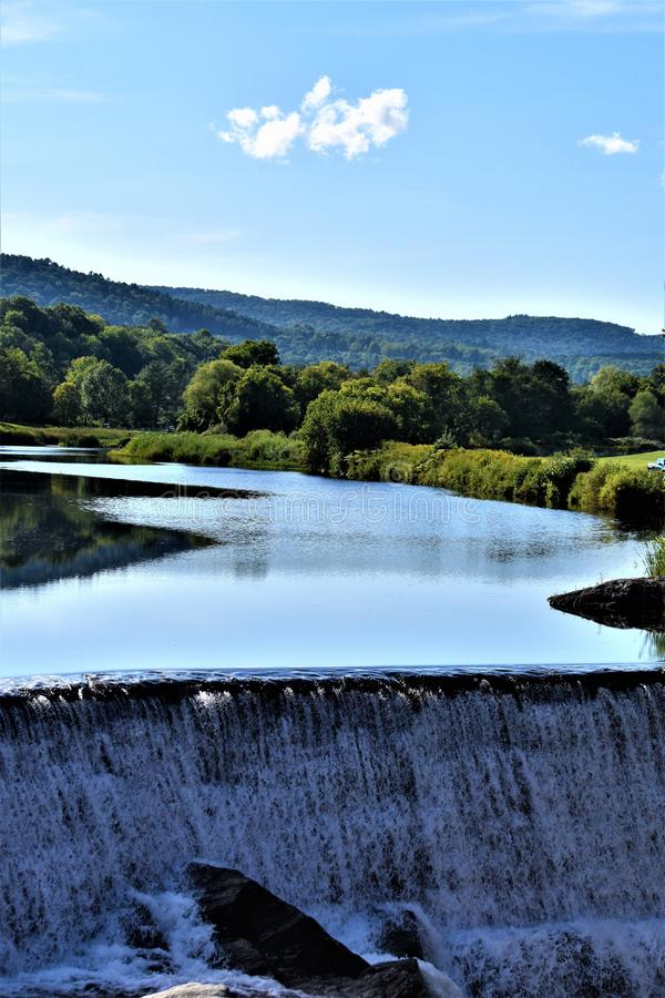 Ottauquechee River and dam, Quechee Village, Town of Hartford, Windsor County, Vermont, United States. Scenic landscape of Ottauquechee River and dam, villlage royalty free stock photo