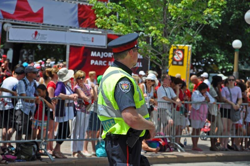 2011 Canada Day in Parliament Hill, Ottawa, Canada. OTTAWA, CANADA - JULY 1, 2011: RCMP police on guard on Canada Day, Ottawa, Ontario, Canada royalty free stock photography