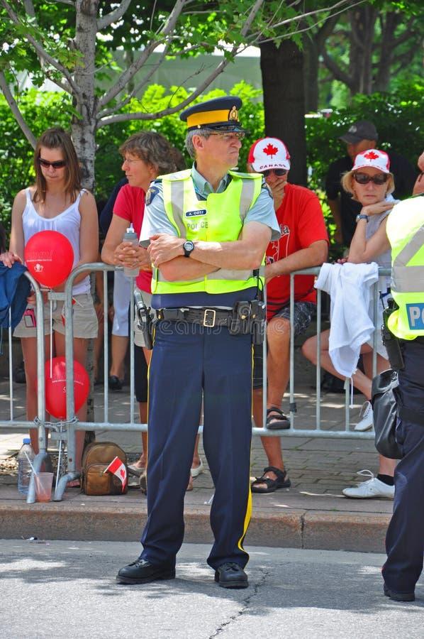 2011 Canada Day in Parliament Hill, Ottawa, Canada. OTTAWA, CANADA - JULY 1, 2011: RCMP police on guard on Canada Day, Ottawa, Ontario, Canada royalty free stock image