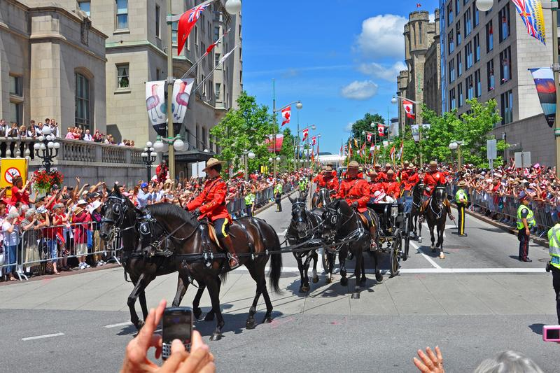 2011 Canada Day in Parliament Hill, Ottawa, Canada. OTTAWA, CANADA - JULY 1, 2011: RCMP riding on Sussex Drive on 2011 Canada Day in downtown Ottawa, Ontario stock photography