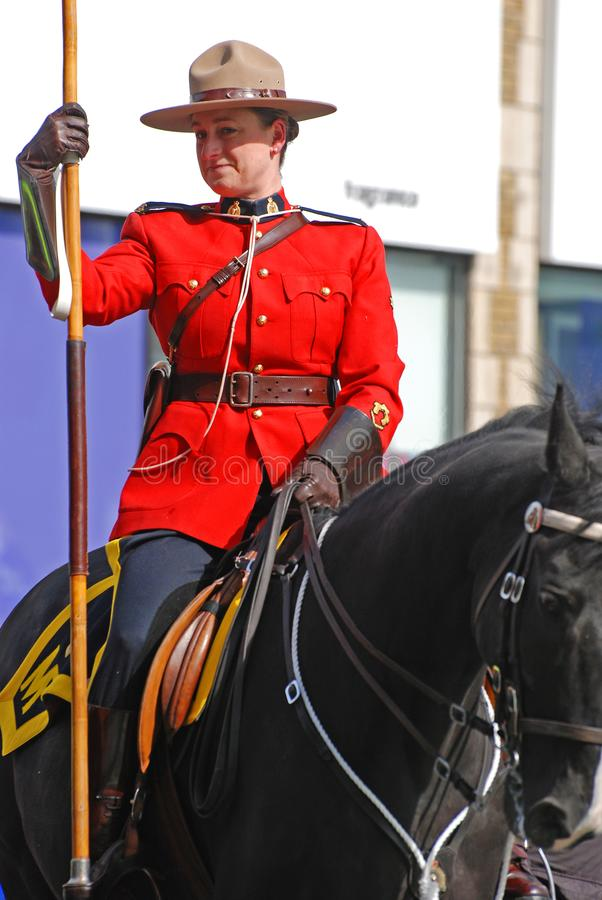 RCMP riding in Saint Patrick's Day parade, Ottawa, Canada. Ottawa, Canada - Mar. 10, 2012: RCMP riding in Saint Patrick's Day Parade in Ottawa, Canada royalty free stock images
