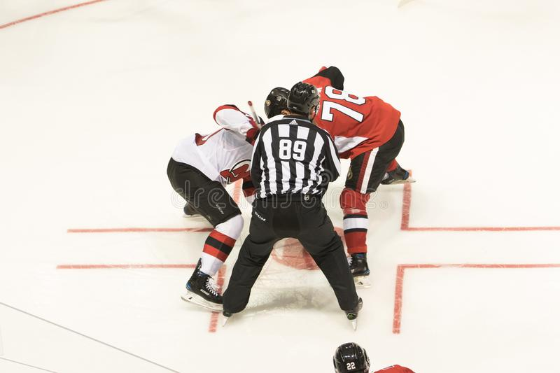 NHL Faceoff. The Ottawa Senators vs New Jersey Devils in NHL action. The two teams here faceoff during the National Hockey League game royalty free stock photography