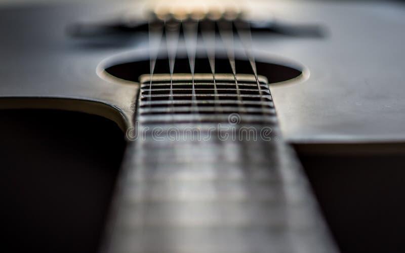 Ottenga vicino al dettaglio della chitarra fotografia stock libera da diritti