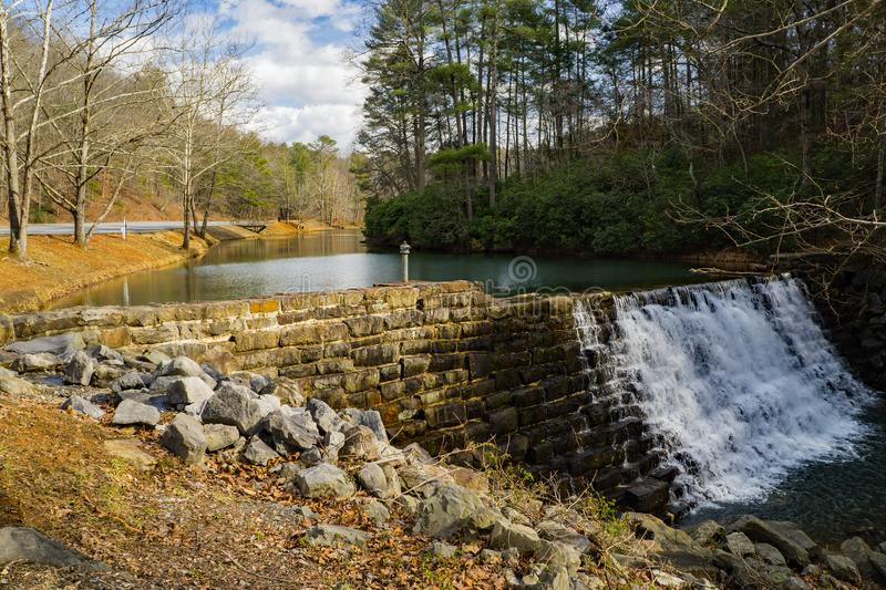 Otter Lake and Stone Dam, Blue Ridge Parkway. A view of Otter Lake and the stone dam located on the Blue Ridge Parkway, Virginia, USA stock image