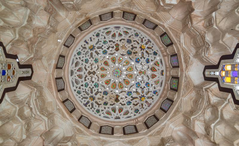 Carved plaster dome decorated with colored glass pieces of a pergola in front of El sehemy historical house, Cairo, Egypt. Ottoman era carved plaster dome stock image