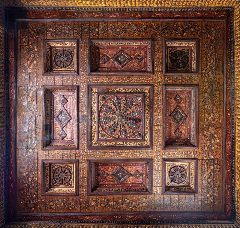 Ottoman era decorated wooden ceiling with golden floral pattern decorations at historic House of Egyptian Architecture stock photography