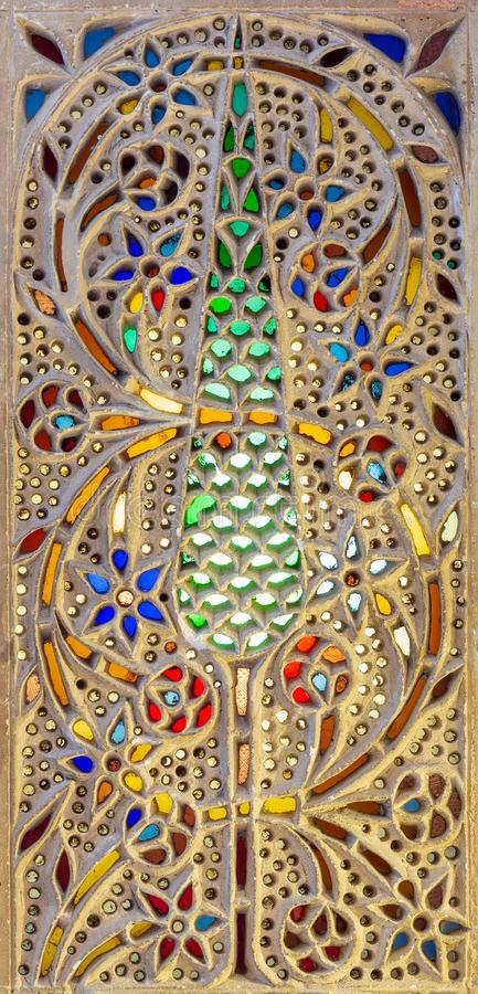 Ottoman era Perforated stucco window decorated with colorful stain glass with floral patterns. Cairo, Egypt stock photos