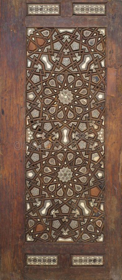Ottoman style wooden ornate door leaf tongue and groove assembled, inlaid with ivory, ebony and bone stock photos