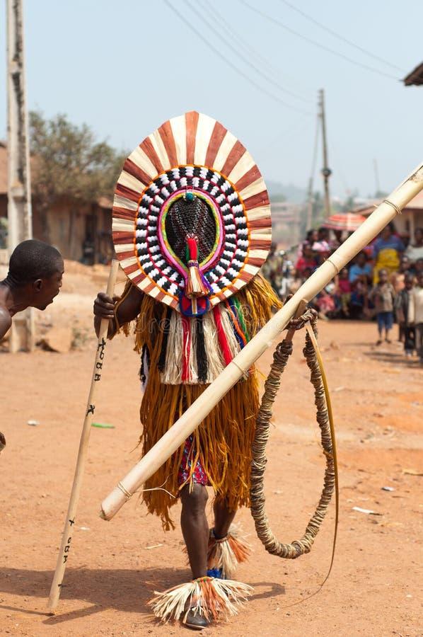 Otuo Ukpesose festival - Itu-maskerad i Nigeria royaltyfri foto