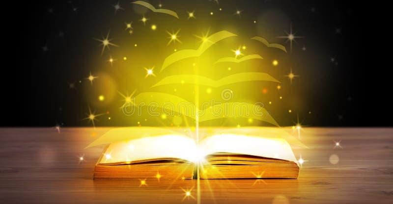 Otwarta książka z złotej łuny latania papieru stronami zdjęcie royalty free