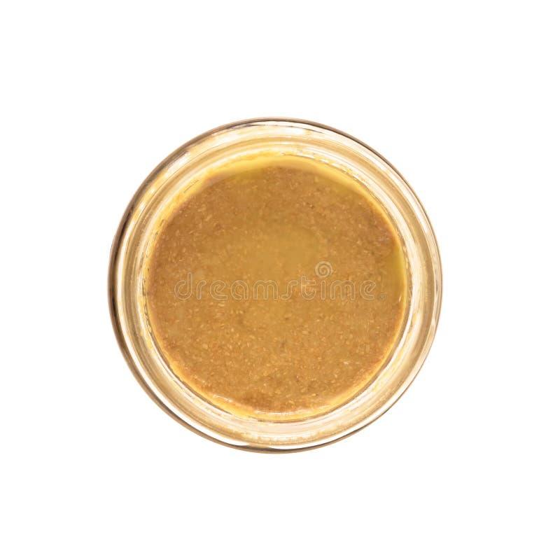 Otwarty szklany słój z dokrętki masłem, hummus lub sezamowym pasty tahini, zdjęcia stock