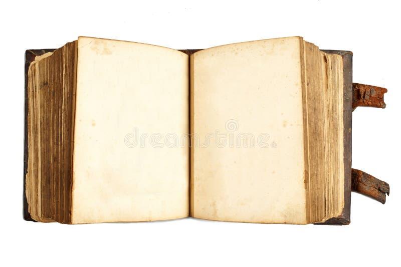 Otwiera antyczną książkę z pustymi stronami odizolowywać na bielu obraz royalty free