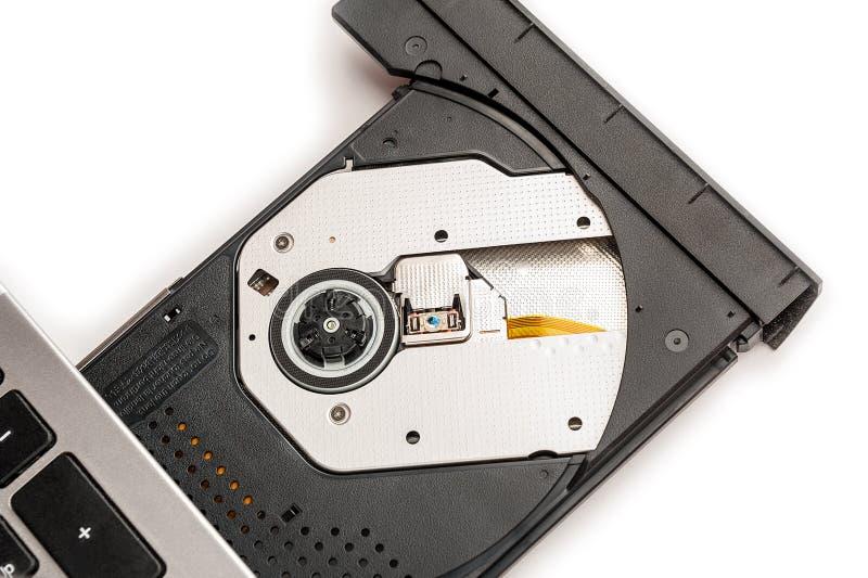 Otwiera okulistyczną CD/DVD dyska przejażdżkę na notatniku fotografia stock