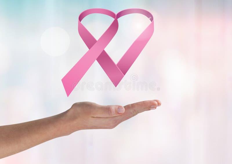 Otwiera rękę z różowym faborkiem dla nowotwór piersi świadomości zdjęcia stock