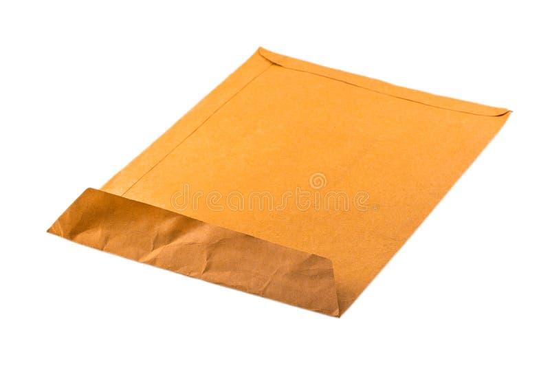 Otwieram używał żółtą kopertę odizolowywającą na białym tle zdjęcie stock