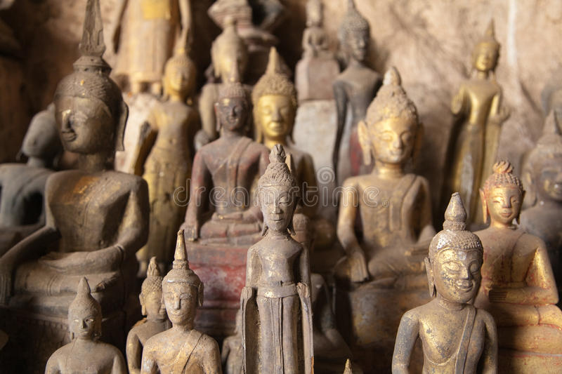 Ou Pak Caves with Buddha statues, Laos royalty free stock image