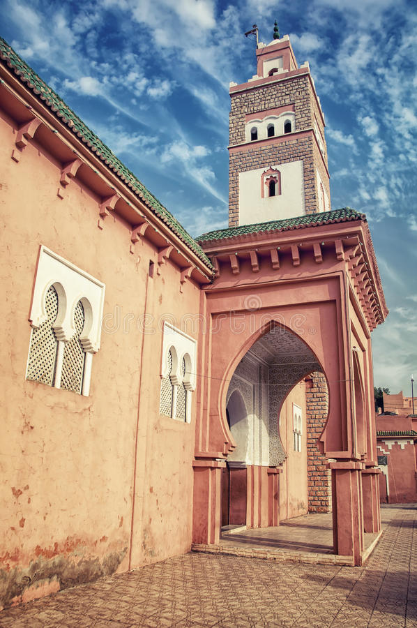 Ouarzazate in Morocco. Minaret of an old Mosque in berber town Ouarzazate, Morocco royalty free stock images