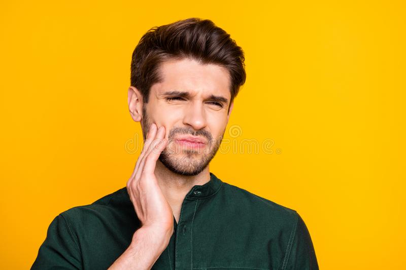 Ouch. Close up photo of upset sad guy feel ill suffer from disease toothache touch his cheek face cry need medical. Dentistry treatment, wear casual style royalty free stock photos