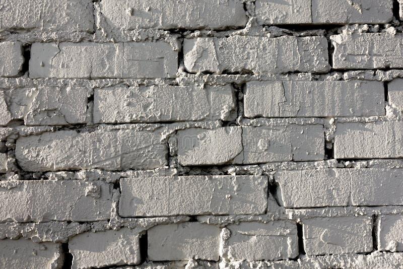 Oud bakstenen muurpatroon van witte kleur van moderne decoratieve ongelijk van de ontwerpstijl Close-up stock afbeelding